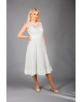 Сукня молочна з фігурними рельєфами